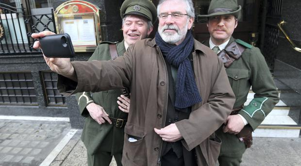 Gerry Adams takes a selfie with Jim Roche and Dave Swift at Sinn Fein's launch of events to mark the 1916 Rising centenary