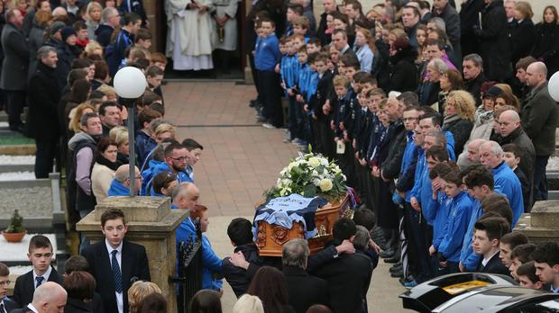 Classmates formed a guard of honour during Oisin's funeral in his home village of Belcoo