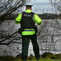 A police officer on the shores of Lough Neagh