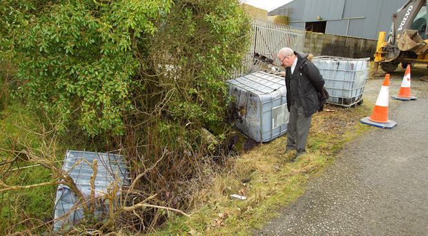 Sunday Independent reporter Jim Cusack at the scene on the Monaghan/Armagh border where diesel sludge was dumped into a stream which flows into Lough Ross