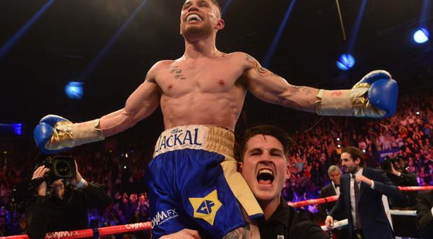 Just champion: Carl Frampton celebrates after his powerful win over American Chris Avalos