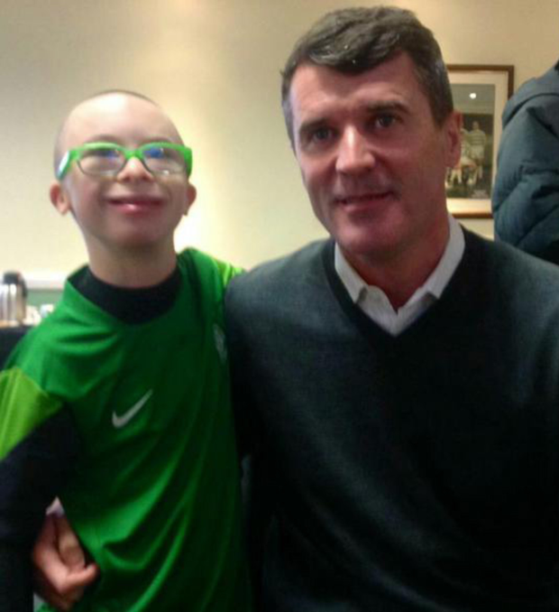 Lurgan's Jay Beatty meets Manchester United and Celtic legend Roy Keane as he picks up his Goal of the Month prize yesterday