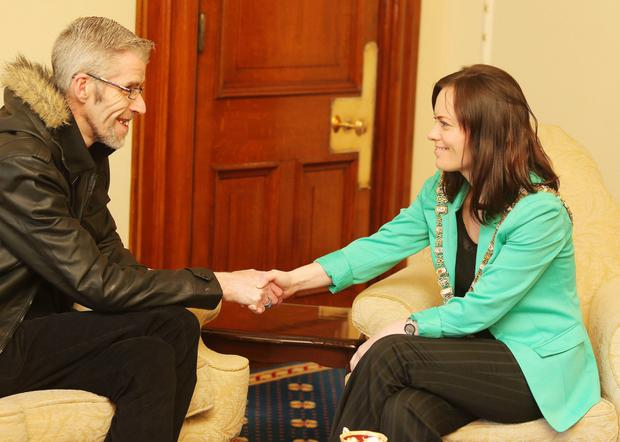 Paul Finlay-Dickson meets Lord Mayor of Belfast, Nichola Mallon, over the campaign of homophobic attacks on his house in north Belfast. Mr Finlay-Dickson recently lost his husband Maurice to cancer