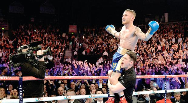 Carl Frampton celebrates his win on the shoulders of trainer Shane McGuigan on Saturday night