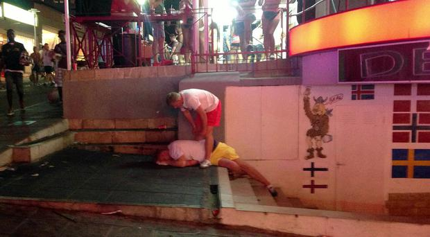 Tourists on the Punta Ballena strip in Magaluf after a night out in the town. Town hall bosses are set to ban drinking in the streets of the resort to crack down on drunkeness.
