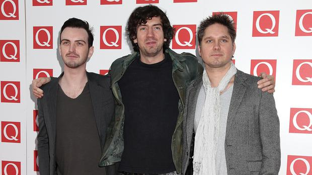 Snow Patrol drummer Jonny Quinn, right, addressed business figures on how new technology has impacted his industry