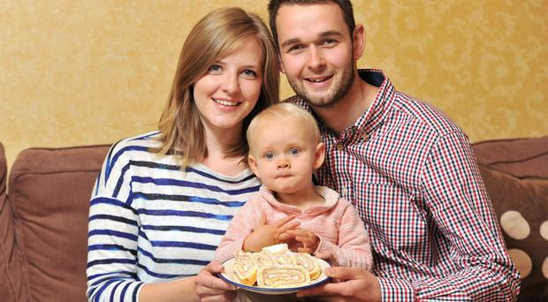 Daniel McArthur, manager of family business Ashers Bakery, with his wife Amy and daughter Robyn