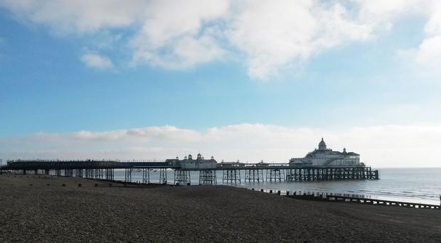 Clouds over Eastbourne Pier, as the warm weather is set to give way to high winds and rain