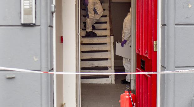 A forensics officer examines the scene at a house in Newry
