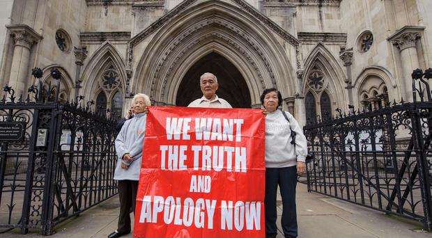 Three relatives of the victims of the Batang Kali killings outside the Royal Courts of Justice in 2012