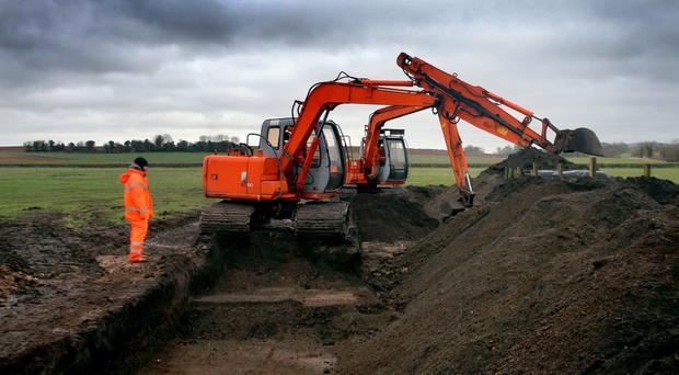 Forensic teams begin their dig in Co Meath yesterday for the remains of IRA victim Joe Lynskey