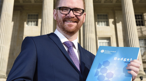 Finance minister Simon Hamilton with a copy of this year's Stormont Budget