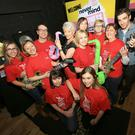 Quiz mistress Pamela Ballantine with all the Action for Children Volunteers who ran Never Mind the Business Unplugged raising over £12,000