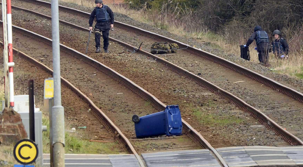 Officers at the scene of a security alert on the railway line at Lurgan yesterday