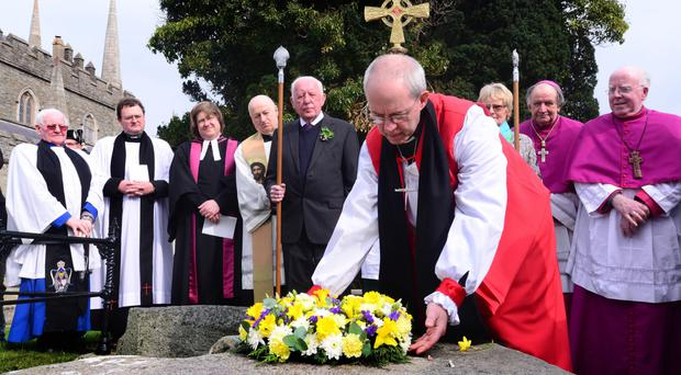 The Archbishop of Canterbury laying a wreath at St Patrick's grave yesterday