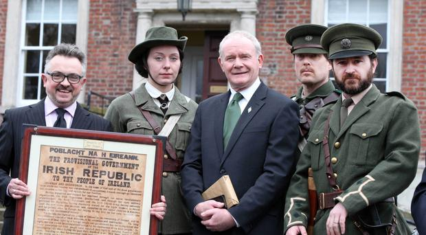 Deputy First Minister Martin McGuinness with actors in period costume yesterday at the 1916 Easter Rising event in Clifton House, Belfast, including Bartle D'Arcy (left), who is helping organise the centenary plans
