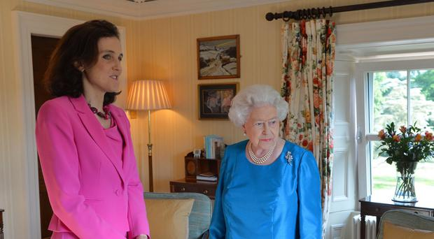 The Queen and Secretary of State for Northern Ireland Theresa Villiers during a private audience at Hillsborough Castle