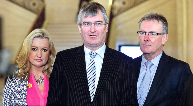 Tom Elliot speaking to the media in the Great Hall at Stormont flanked by Joanne Dobson and Mike Nesbitt