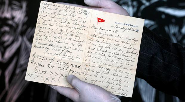 The last letter ever to be written on board the Titanic is inspected by Titanic Belfast CEO Tim Husbands yesterday