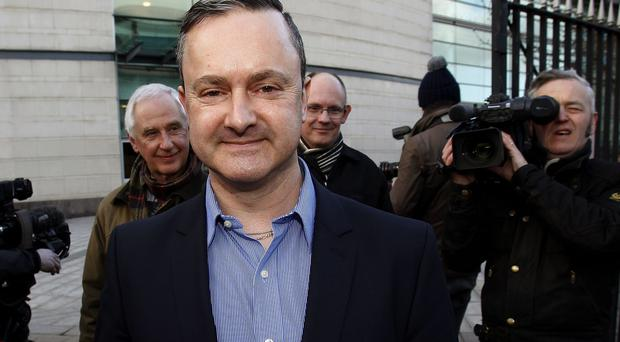 Gay rights activist Gareth Lee leaves Belfast County Court where Northern Ireland's Equality Commission is backing a legal action against Ashers Bakery