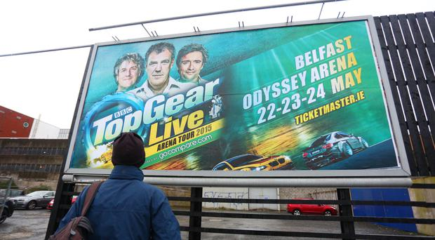A passer-by views a billboard for the Top Gear show in Belfast