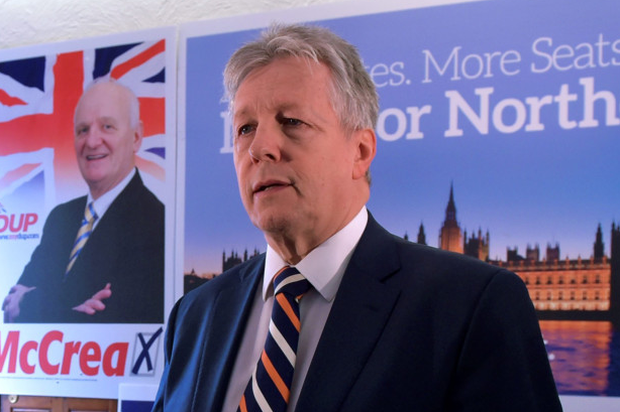 DUP leader Peter Robinson talks to reporters yesterday in Antrim
