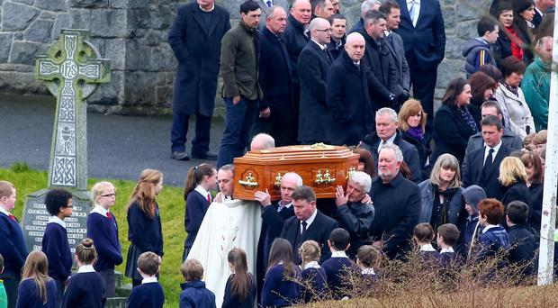 Classmates form a guard of honour at the funeral of Stephen McElroy