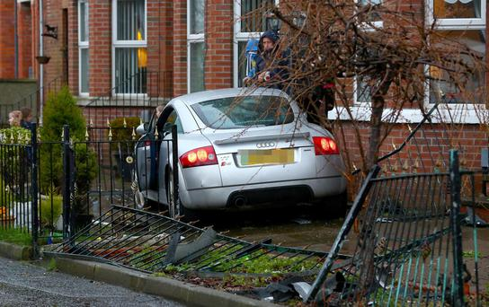 The Audi TT which ploughed through the fence and struck the wall of a property in Kansas Avenue off the Antrim Road last night
