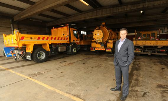 DUP MLA Paul Frew with the DoE Roads Service vehicles parked at the Ballykeel depot in Ballymena