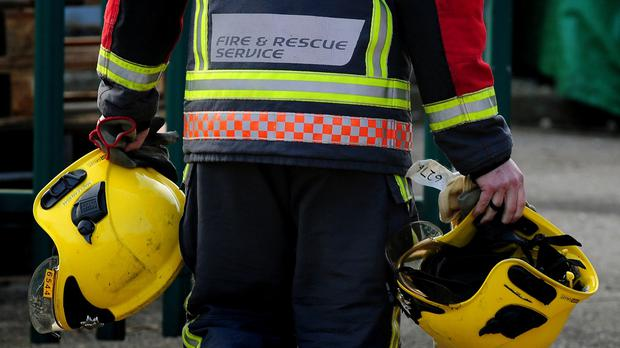 Three people are critically ill after a blaze at a house in Belfast, fire service officials said
