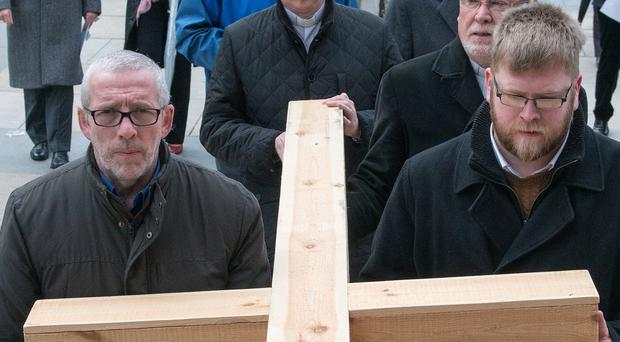 Bearing witness: the faithful lead a Walk of Witness through Londonderry yesterday to mark Good Friday