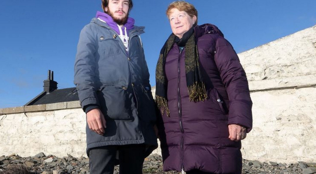 Ardglass fisherman Ross Mulhall with Killough resident Eileen Peters at the lighthouse last year. Both are strongly opposed to plans for a new LED light