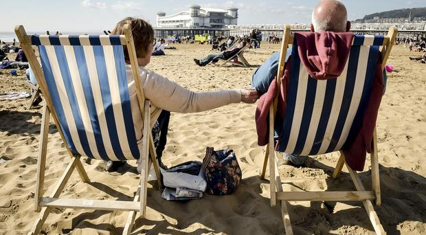 People enjoyed the sunny bank holiday weather on Weston-Super-Mare beach, Somerset