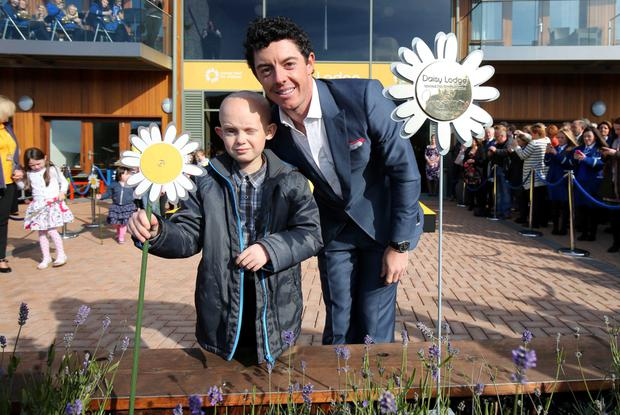 Rory McIlroy with Caleb at the opening of Daisy Lodge children's cancer home in Newcastle