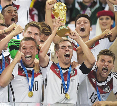 Germany's captain Philipp Lahm raises the World Cup after the final in Rio de Janerio, Brazil, in 2014