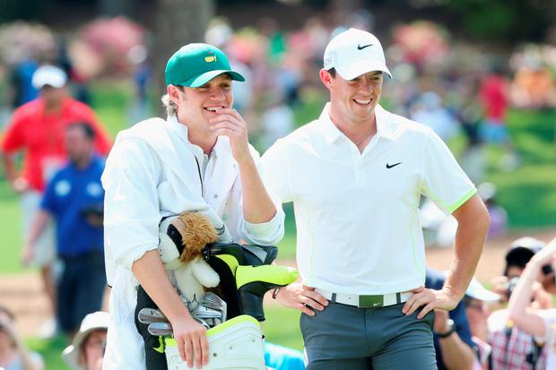 Niall and Rory share a laugh on the course at Augusta yesterday