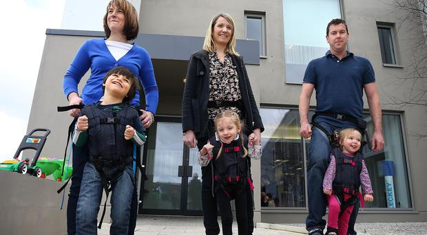 Left to right: Claire and Daniel Smyth, Louise and Bethany Watson and Cameron and Charlotte Taylor using a Firefly Upsee. A new website hopes to put more inventions for children with special needs in the marketplace