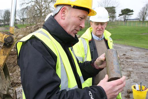 Ciaran McCartie and Eugene Hegarty with the 175-year-old time capsule uncovered during renovation work
