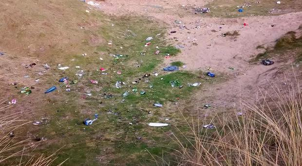 Some of the broken glass and cans left behind by visitors to Portrush over the Easter weekend