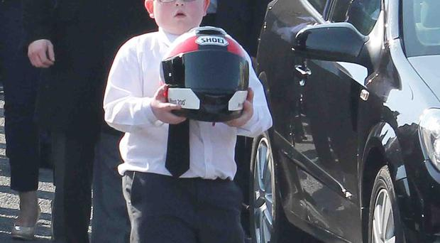 Charlie Anderson with his dad's helmet yesterday