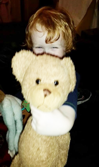 Charlie with his bear after they were brought together again
