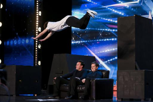 Matt McCreary leaps over hosts Ant and Dec