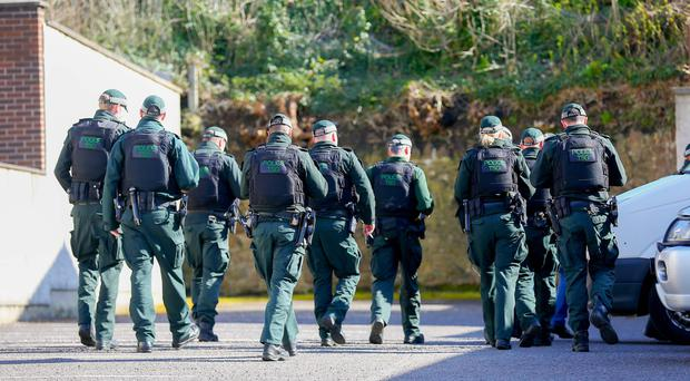 Officers searching surrounding area of Mill road in Comber