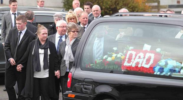 Members of the late Ricky Patterson's family follow his hearse after a service at Still Waters Elim Church in Coleraine yesterday. Ricky was laid to rest in Coleraine cemetery