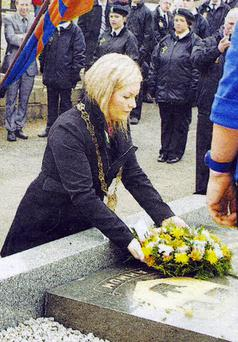 The chairman of Newry, Mourne and Down Council, Naomi Bailie, laying a wreath at the Easter Rising commemmoration