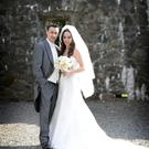 Paul and Laura Heatley after their wedding at St Colmcilles