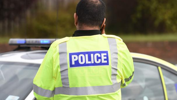 A police officer has been disciplined after a near-collision with a motorist