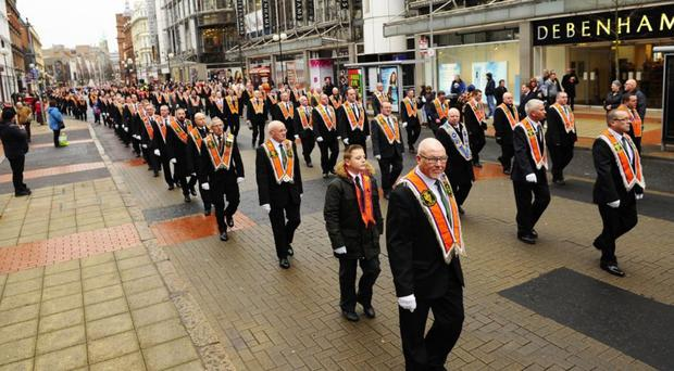 An Orange parade passes along Royal Avenue in February