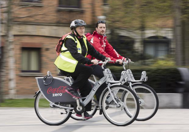 Councillor Aileen Graham and Ross McGill of Sustrans on Belfast's new city bikes