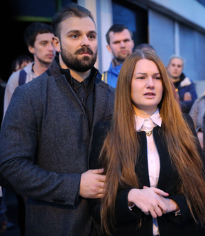 Asta Samaliute and her partner Ben Grigisas join residents in a community protest outside Asta's Glam Factory in east Belfast last week